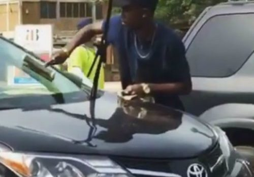Opanka Spotted On The Streets Cleaning Car Screens For Money