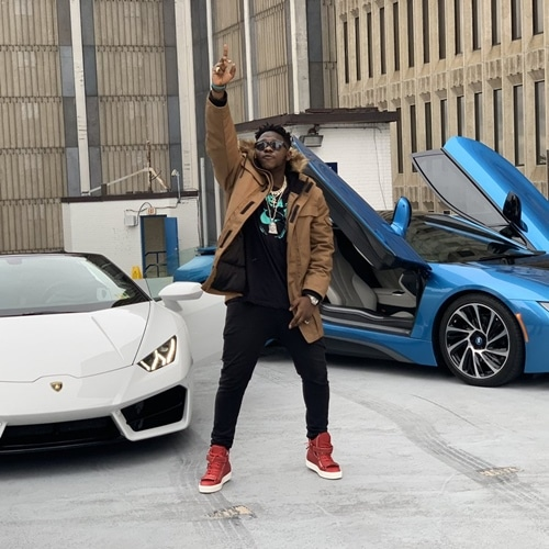 medikal davido father in front of two cars